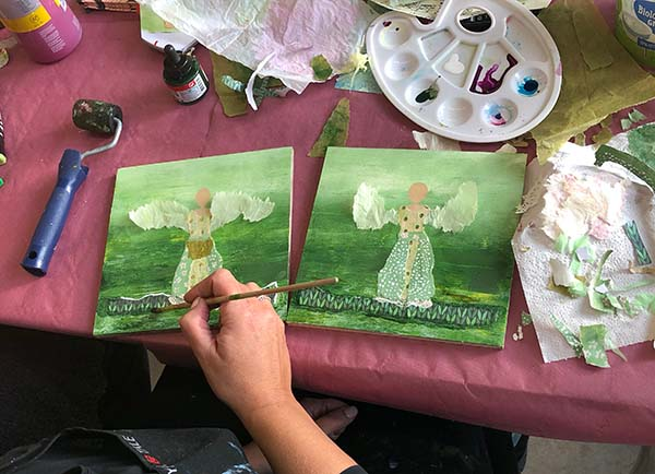 Susan finishing mixed media angels - a painting course by Luz Artworks